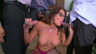 Busty boss Tory Lane sucking three hard pricks in her office image