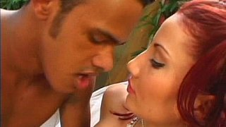 Beautiful redhead babe gets fucked by a black cock image