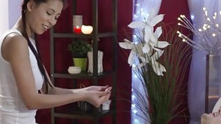 Blindfolded dude gets massage from busty masseuse image