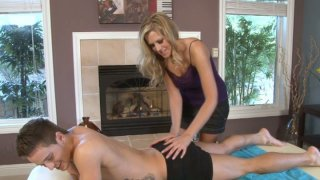 Sexy masseuse Darcy Tyler stretches Mason Star's butt cheeks and sucks his dick image