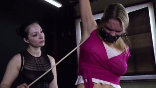 Tatted bitch Rain DeGrey gets tied up and tortured in BDSM video image