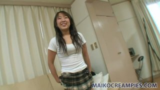 Chubby chick Yuri Takao masturbates with dildo on the couch image