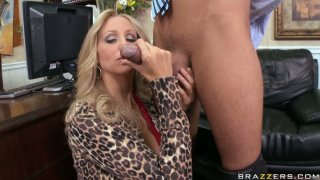 Vamp slut Julia Ann gives a tremendous blowjob to Keiran Lee in the office image