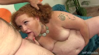 Fat Redhead Scarlett Raven Has Her Mouth and Pussy Drilled by a Thick Cock image