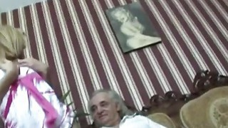 Slutty Blond Sucks Off And Fucks An Old Handicapped Man image