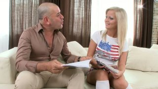 Buxom_blonde_starlet_Sunny_Diamond_gives_blowjob_on_the_couch image