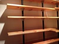 Pipe Shelves Built from Reclaimed Bookshelves