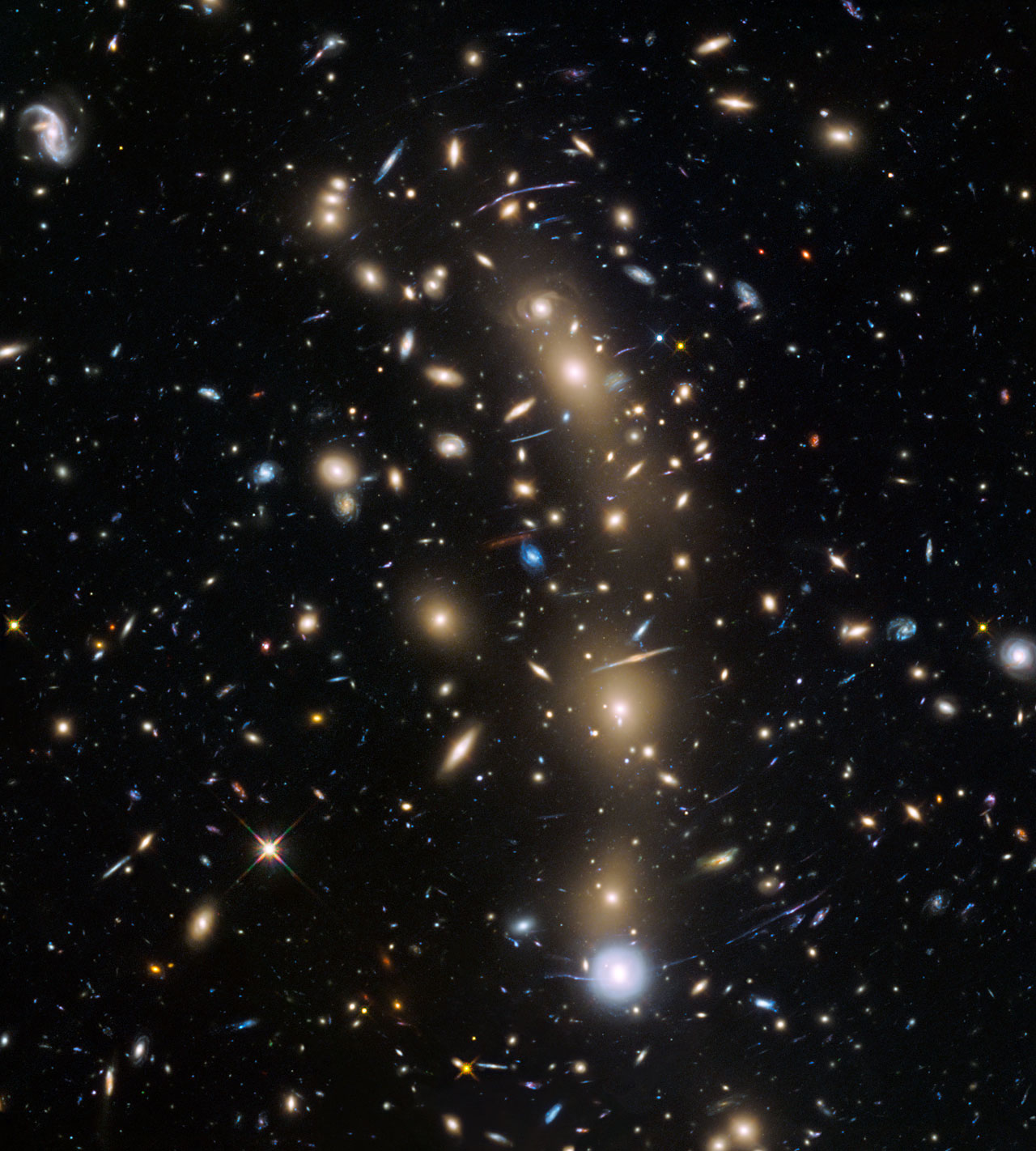 This image from the NASA/ESA Hubble Space Telescope shows the galaxy cluster MACS J0416.1–2403. This is one of six being studied by the Hubble Frontier Fields programme, which together have produced the deepest images of gravitational lensing ever made.  Due to the huge mass of the cluster it is bending the light of background objects, acting as a magnifying lens. Astronomers used this and two other clusters to find galaxies which existed only 600 to 900 million years after the Big Bang.  Credit: NASA, ESA and the HST Frontier Fields team (STScI)