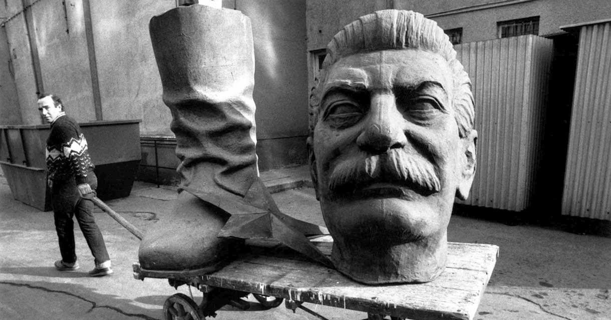 A statue of Stalin is carted away after the fall of the Soviet Union