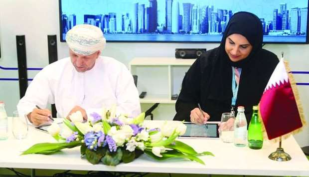 Senior officials of Mada and ITA at the signing of the MoU