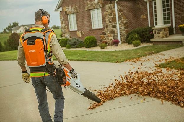 man using battery powered leaf blower