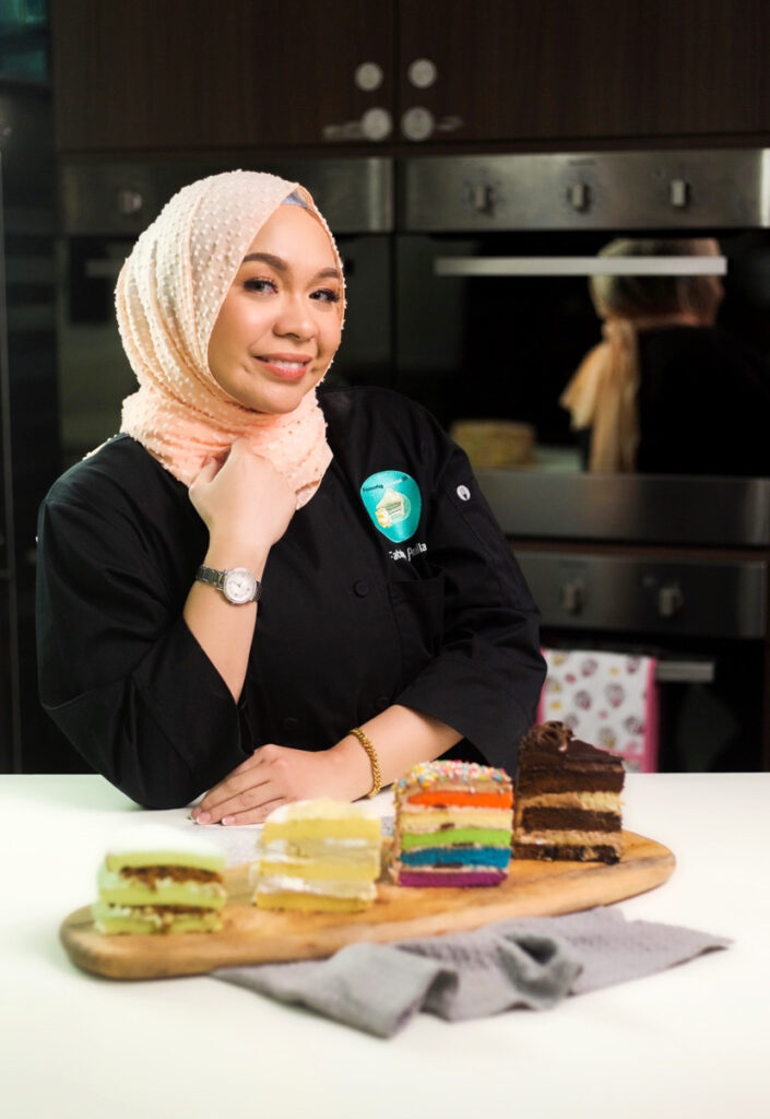 Fateha Abdullah with slices of her popular cakes