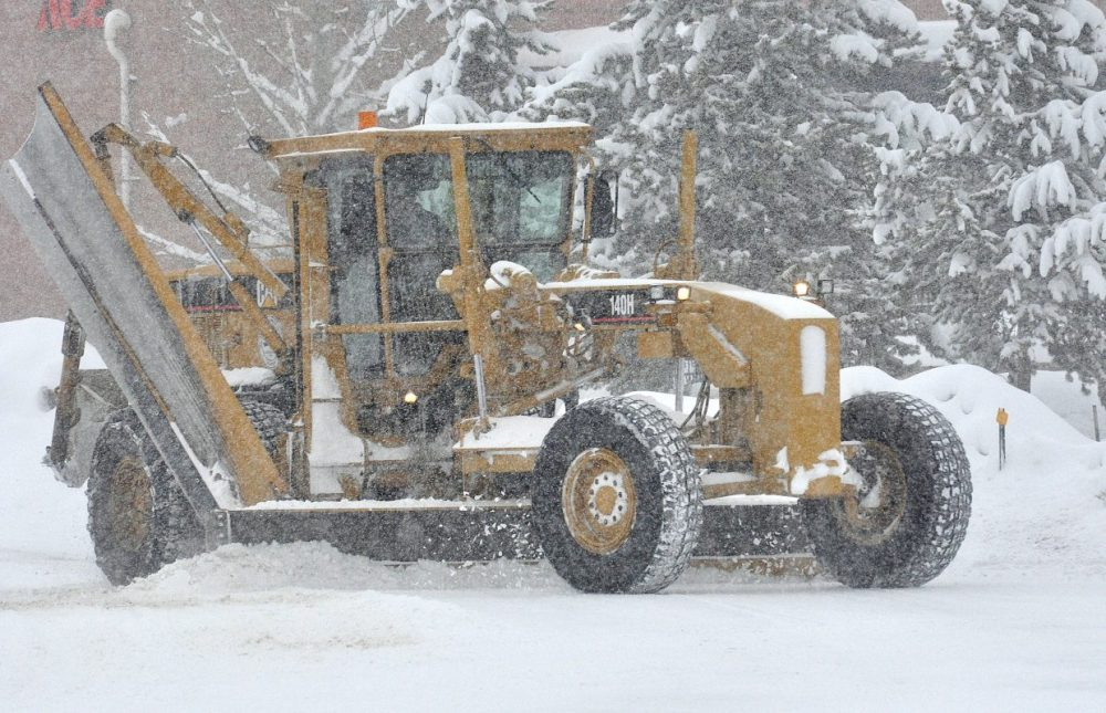 medium resolution of a road grader clears snow from a street in west steamboat springs on wednesday