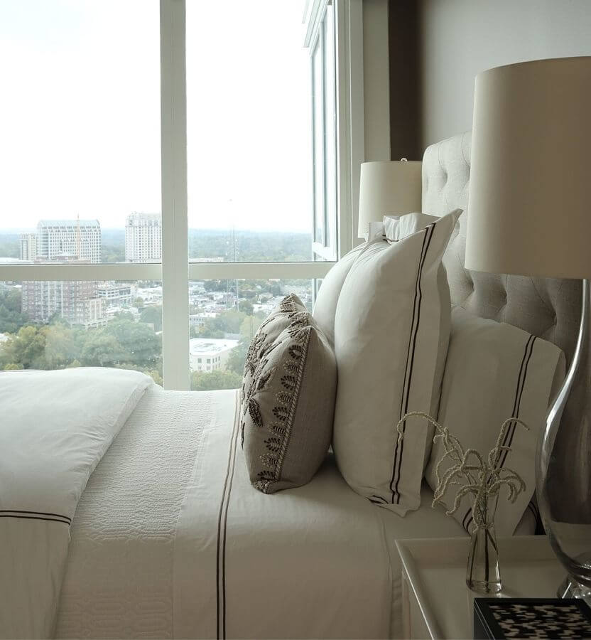 unusual chair company chichester herman miller eames repair this stunning high rise home is an urban oasis embroidered pillows add texture and pattern to the peaceful master bedroom