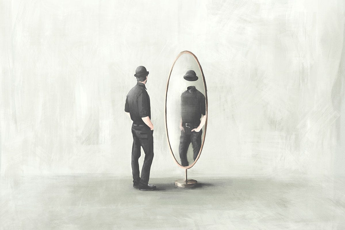 Man Looking Away from Faceless Reflection in Mirror
