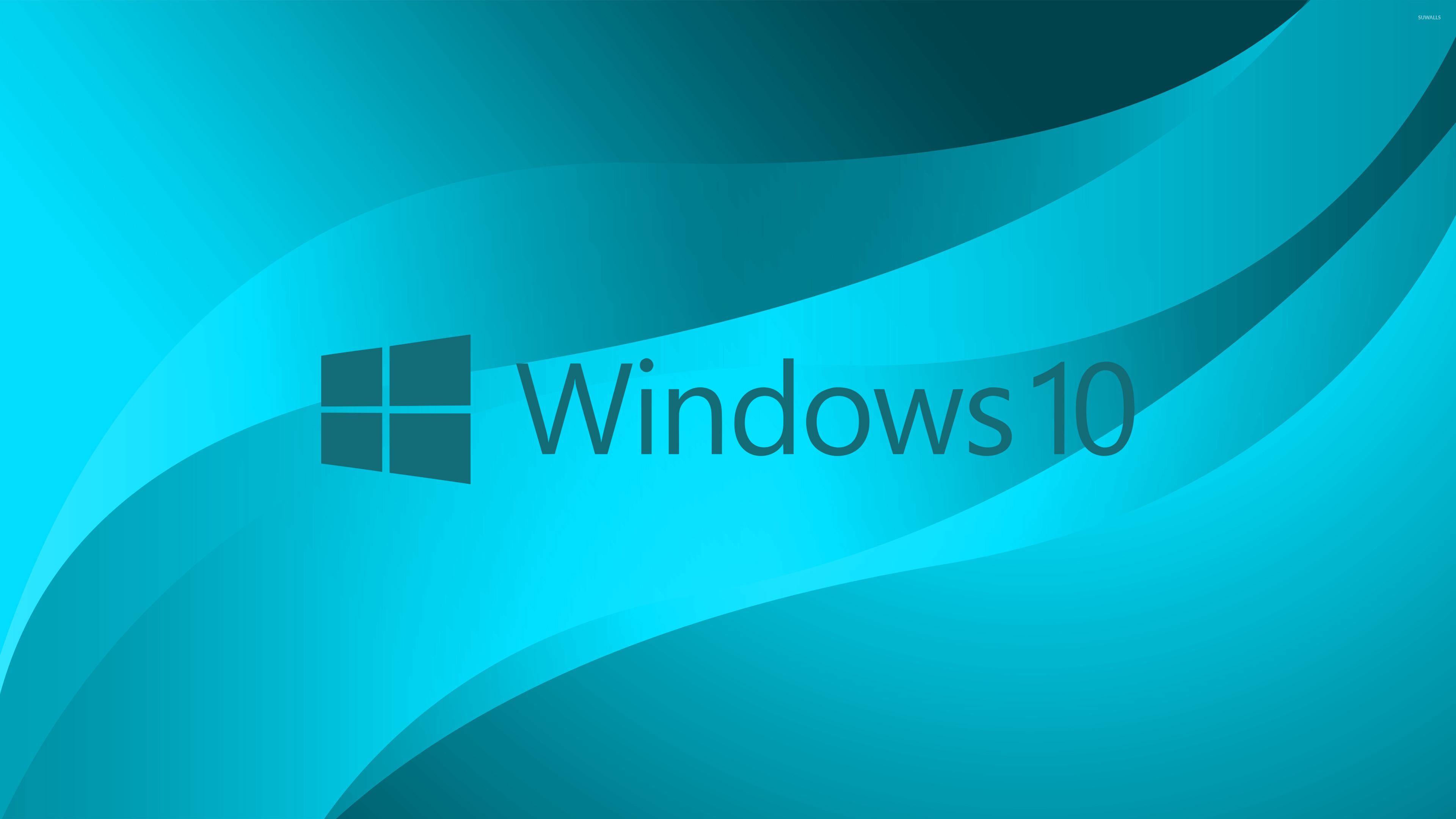 windows 10 blue text logo on light blue wallpaper - computer