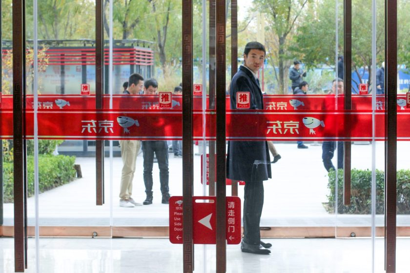 A doorman keeps watch at online retailer JD's Beijing headquarters, pictured here in November 2018. (Image credit: TechNode/Cassidy McDonald)