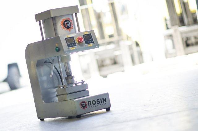 A Rosin Industries pneumatic heat press cannabis extraction unit.