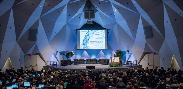 Photo of stage and audience at Human Gene Editing Summit