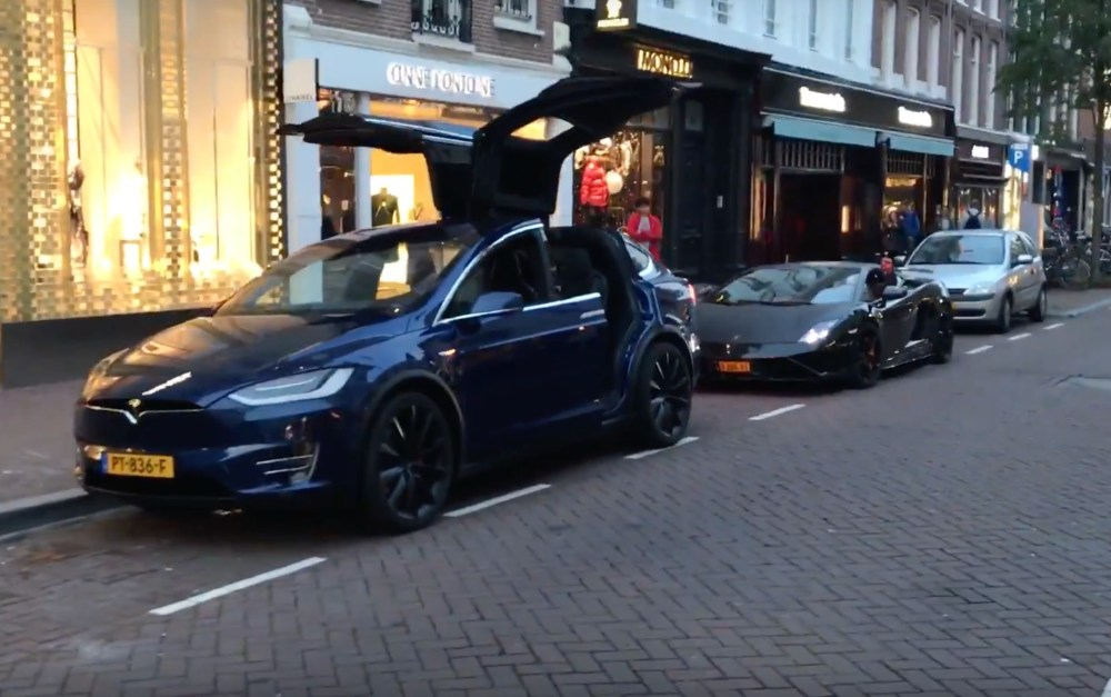 medium resolution of watch this tesla model x steal a lamborghini s thunder with a song and dance