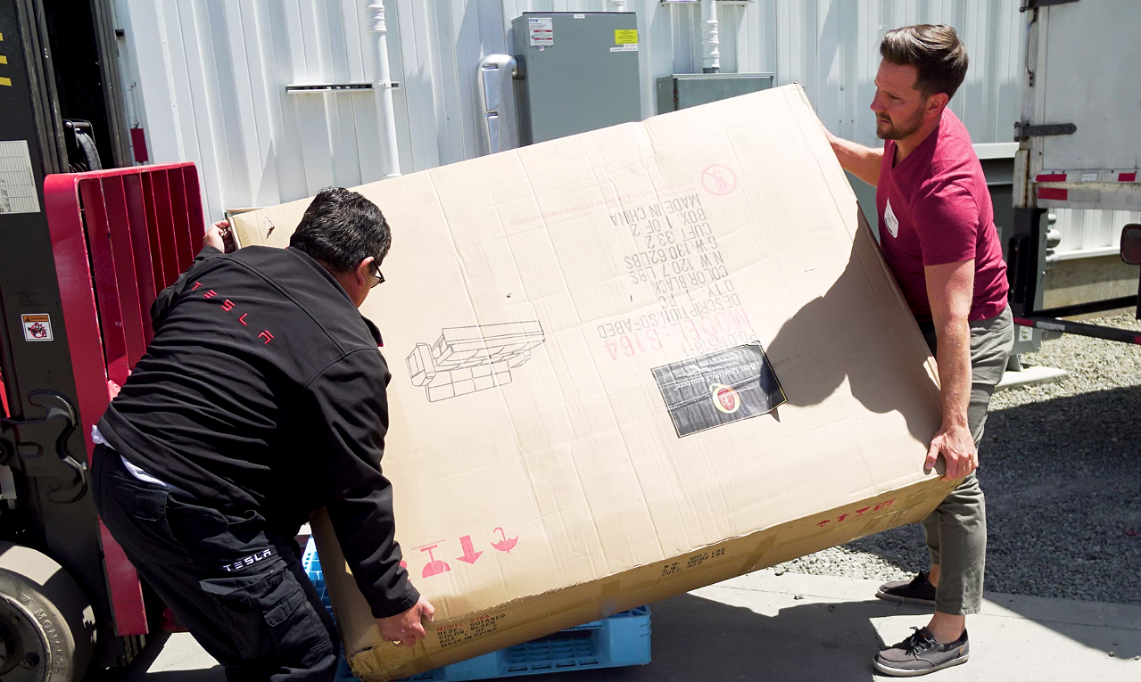 donate sofa to charity leather 3 seater tesla fans deliver elon musk s new couch raise 18k for