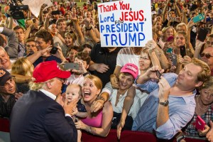 What does that sign say? Thank you Lord for Jesus President Trump... makes no sense...