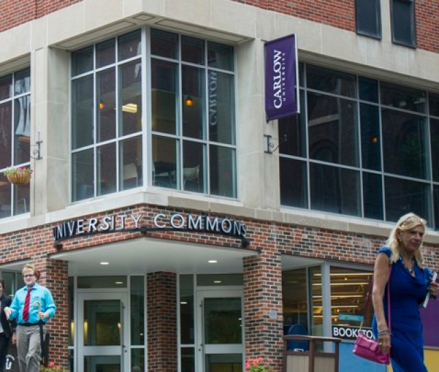 A Building On The Carlow University Campus With A Sign That Reads University Commons