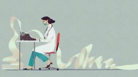 A woman sitting at a typewriter