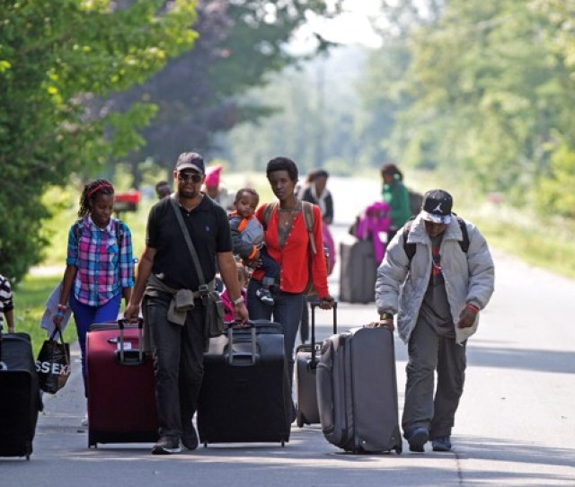 Asylum Seekers Walk Down Roxham Road To Cross Into Quebec At The U S Canada Border
