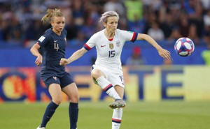 United States forward Megan Rapinoe (15) controls the ball ahead of France defender Marion Torrent (4) in the first half of a quarterfinal match in the FIFA Women's World Cup France 2019