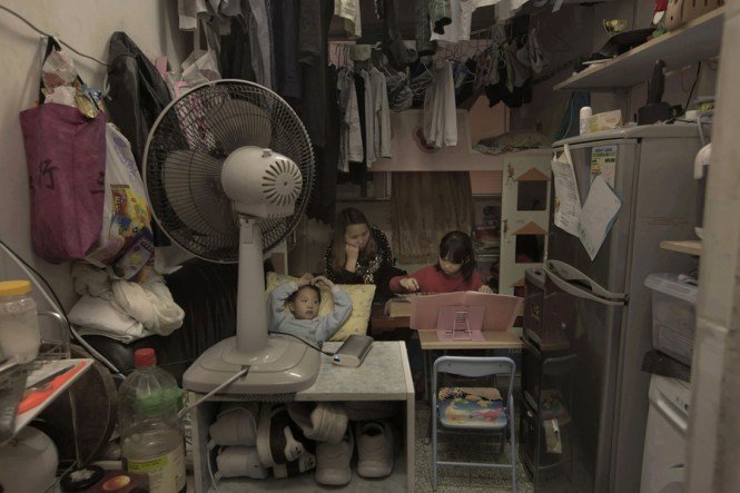 In This March 17 2017 Photo Li Suet Wen And Her Son 6 Daughter 8 Are Shown Their 120 Square Foot Room Crammed With A Bunk Bed Small Couch