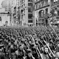 """The First Battalion of the 308th Infantry, the famous """"Lost Battalion"""" of the 77th Division's Argonne campaign of the Great War, marches up New York's Fifth Avenue just past the Arch of Victory during the spring of 1919. [1500 x 956]"""