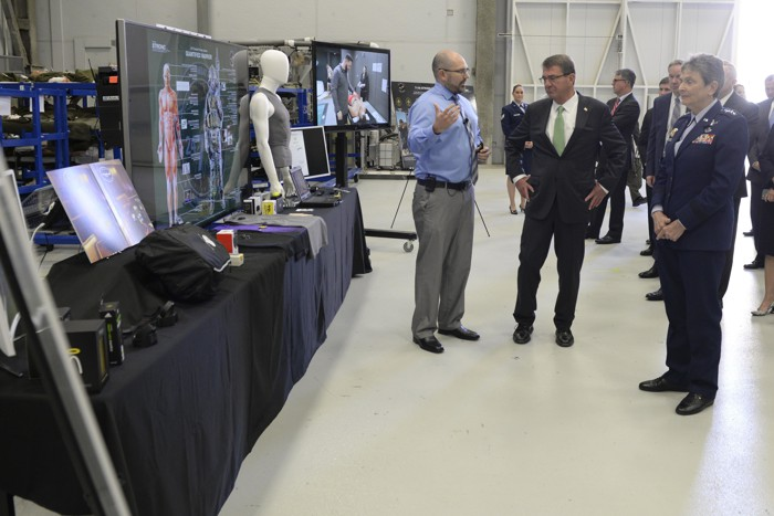 Dr. Josh Hagen of the U.S. Air Force's 711th Human Performance Wing briefs then-Defense Secretary Ash Carter on wearable sensor technology during a late 2016 visit at Wright-Patterson Air Force Base, Ohio