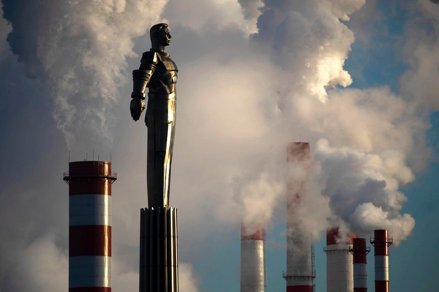 Steam rises from a heating plant behind a monument to Soviet cosmonaut Yuri Gagarin.
