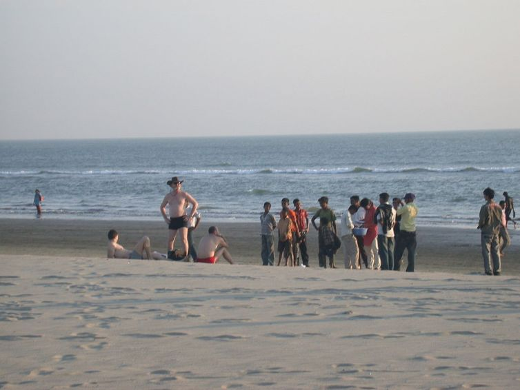 Ukranian tourists attract the attention of locals on Cox's Bazar beach. Credit: Matt Zanon/Wikimedia, CC BY-ND