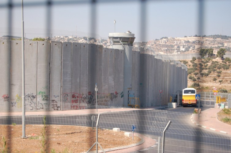 Israel's West Bank separation barrier is a major source of tension between Israelis and Palestinians. The International Court of Justice ruled its construction illegal in 2004. Credit: tgraham/Flickr, CC BY-NC