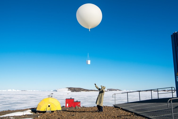 Launching an ozone-measuring balloon from Australia's Davis Research Station in Antarctica.