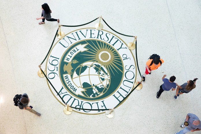 Students are seen from above at the Marshall Student Center at the University of South Florida in Tampa, Florida.