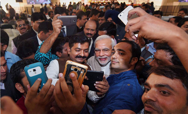 Prime Minister Narendra Modi poses for the selfies with reporters during the Diwali Mangal Milan at BJP headquarters in New Delhi. Credit: PTI/Files