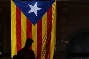 A man is silhouetted in front of an Estelada (Catalan separatist flag) in Ripoll town, north of Barcelona, Spain, August 20, 2017. REUTERS/Albert Gea