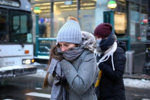 A woman bundles up against the cold temperature as she walks in Manhattan in New York City, New York, US, January 5, 2018. Credit: Reuters/Amr Alfiky