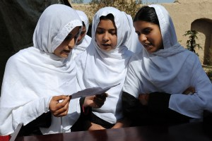 Students of the Farah Women's Empowerment Center perform a song at the official dedication of the center, March 10, 2010, Farah, Afghanistan. Caption and credit: isafmedia/Flickr, CC BY 2.0