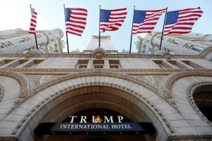 Flags fly above the entrance to the new Trump International Hotel on its opening day in Washington, DC, U.S. on September 12, 2016. Credit: Reuters/Kevin Lamarque/Files