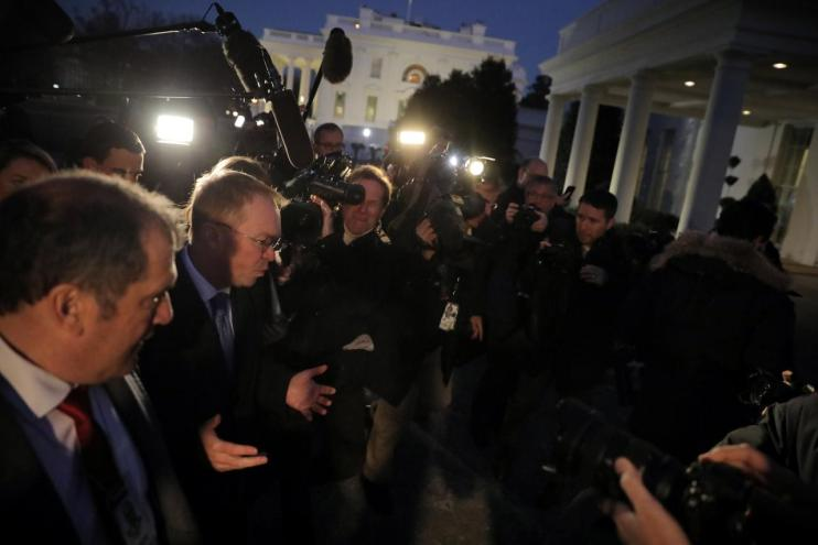 White House budget director Mick Mulvaney talks with reporters at the White House in Washington, US, January 19, 2018. Credit: Reuters/Carlos Barria