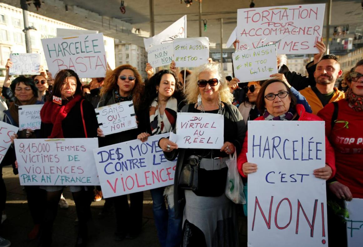 Women hold placards during a gathering against gender-based and sexual violence in Marseille, France, October 29, 2017. Credit: Reuters/Jean-Paul Pelissier