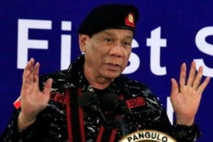 Philippine President Rodrigo Duterte, wearing a military uniform, gestures as he delivers a speech during the 67th founding anniversary of the First Scout Ranger regiment in San Miguel town, Bulacan province, north of Manila, Philippines November 24, 2017. Credit: Reuters/Romeo Ranoco/File Photo