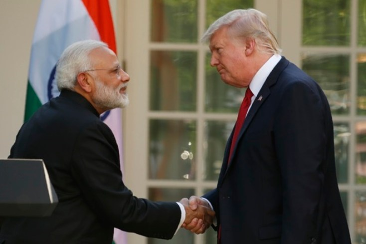 US President Donald Trump (R) greets Indian Prime Minister Narendra Modi. Credit: Reuters/Kevin Lamarque
