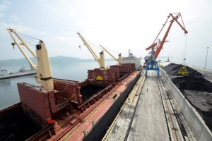 A cargo ship is loaded with coal during the opening ceremony of a new dock at the North Korean port of Rajin July 18, 2014. Credit: Reuters/Yuri Maltsev