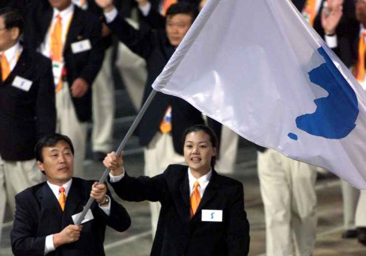 A flag with Korean peninsula unification symbol at the opening ceremony of the Sydney 2000 Olympic Games. Credit: Reuters/Andy Clark