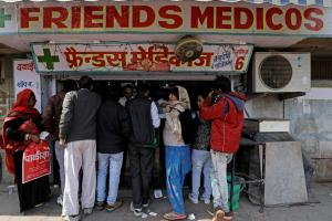 People crowd outside a chemist store in New Delhi, India February 2, 2018. Credit: Reuters/Saumya Khandelwal